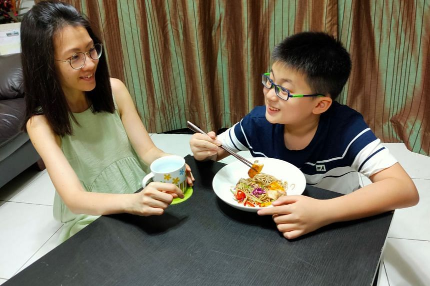 Principal dietitian Wong Yuefen (left) and her son Matthias enjoying a healthy dish of cold soba with tangy salmon.