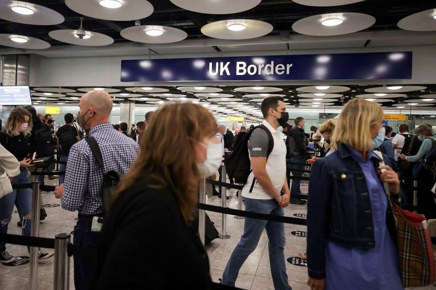 Arriving passengers queue at UK Border Control at Heathrow Airport's Terminal 5 in London.