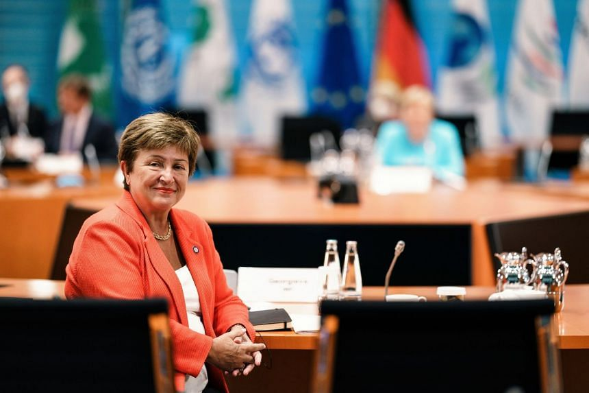 IMF managing director Kristalina Georgieva (left) poses for a photo during a meeting with directors of the ILO, IMF, OECD, World Bank and others to discuss the global economy, in Berlin, Germany, in August 2021.