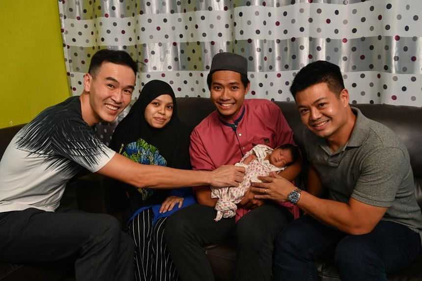 (From left) Dr Chow Yuen Ho, Madam Mardhiah Abdul Malek, Mr Muhammad Annur Mohammad and Mr Adrian Khoo with the baby who was born in the Tada Car.