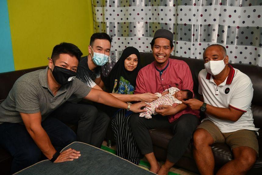 (From left) Mr Adrian Khoo, Dr Chow Yuen Ho, Madam Mardhiah Abdul Malek, Mr Muhammad Annur Mohammad and Mr Addy Soon with the baby who was born in the Tada Car.