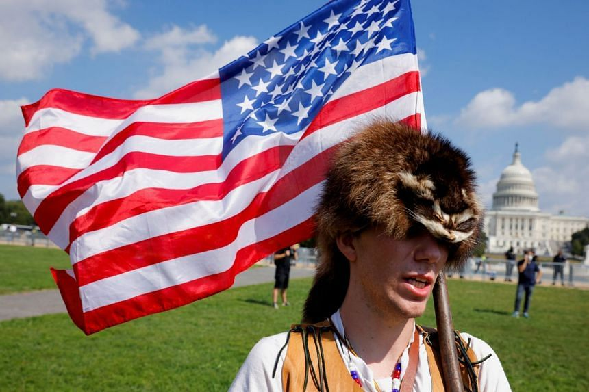A man wearing a raccoon hat talks about his belief that former president Donald Trump won the US 2020 election, at the Capitol, on Sept 18, 2021.
