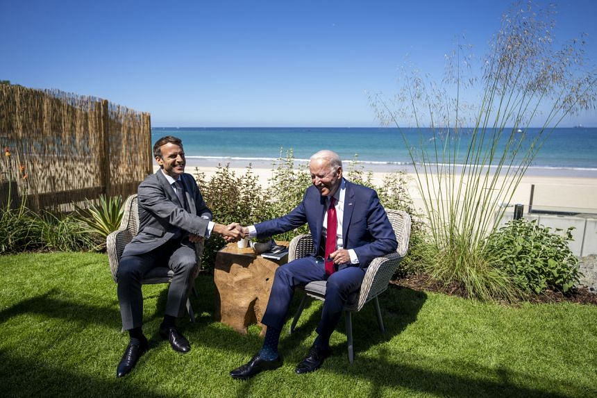 "French President Emmanuel Macron (left) will ask US President Joe Biden (right) for ""clarification""."