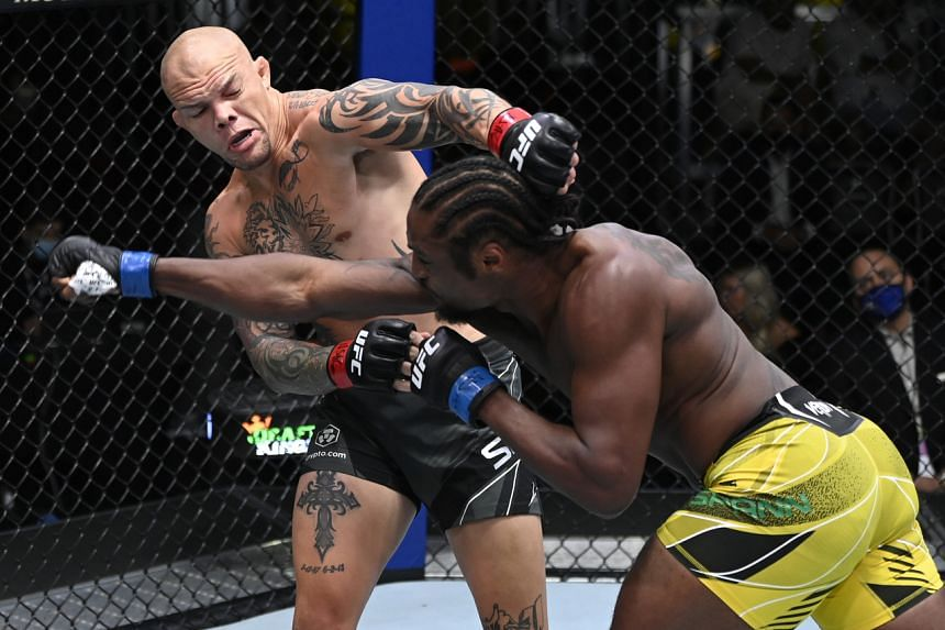 Anthony Smith (left) and Ryan Spann trade punches in a light heavyweight fight during the UFC Fight Night event at UFC APEX on Sept 18, 2021.