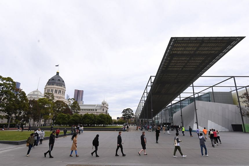 People wait in line at the Melbourne Museum Covid-19 vaccination clinic in Melbourne on Sept 17, 2021.