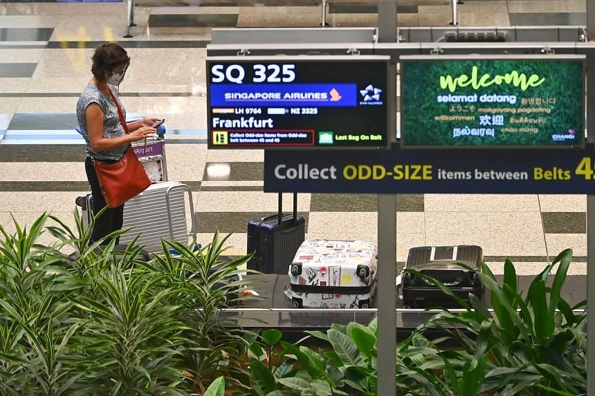 A passenger of Singapore Airlines flight SQ325, the first flight ferrying travellers from Germany under the quarantine-free scheme, at Changi Airport on Sept 8, 2021.
