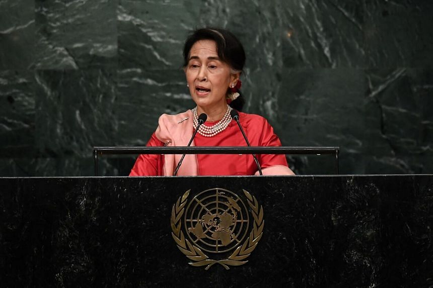 Toppled Myanmar leader Aung San Suu Kyi would comment only after discussions with others in the NLD leadership.