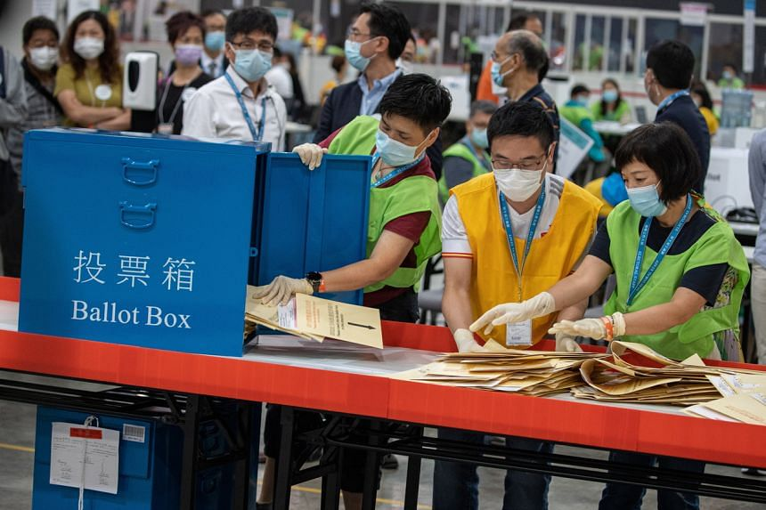 Officials opening a ballot box after the Election Committee Subsector Ordinary Elections in Hong Kong, on Sept 19, 2021.