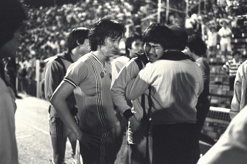 In this photo from 1978, Mat Noh (left) struggled to hold back his tears in the 1978 Malaysia Cup football final at the Merdeka Stadium in Kuala Lumpur.