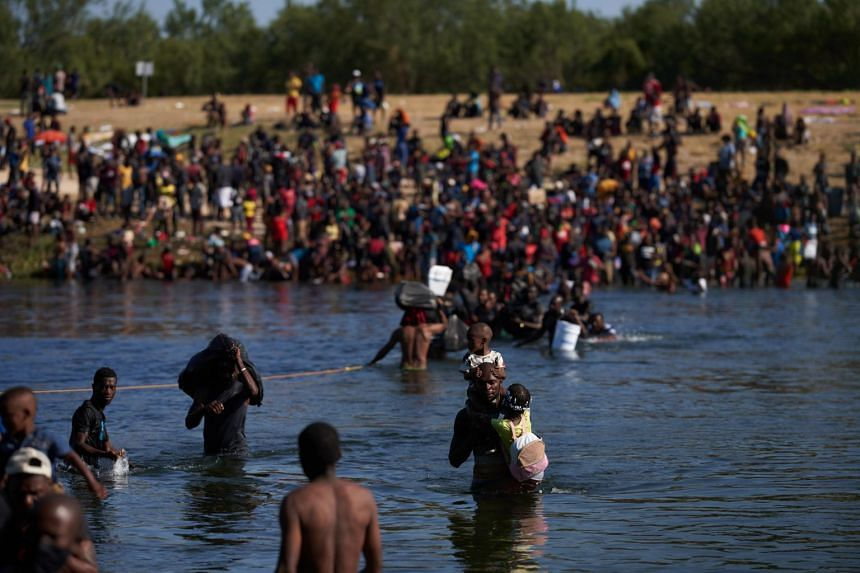 Thousands of migrants, many of them Haitian, illegally cross back and forth between the US and Mexico, on Sept 20.