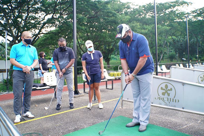 Singapore Golf Association professional Amanda Tan (second from right) with three NTUC union members participating in the U Golf Academy programme at Orchid Country Club.