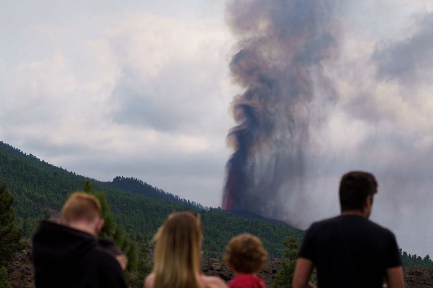 People look at the smoke rising up from the new 'Cumbre Vieja' volcano in La Palma, Canary islands, Spain on Sept 20, 2021.