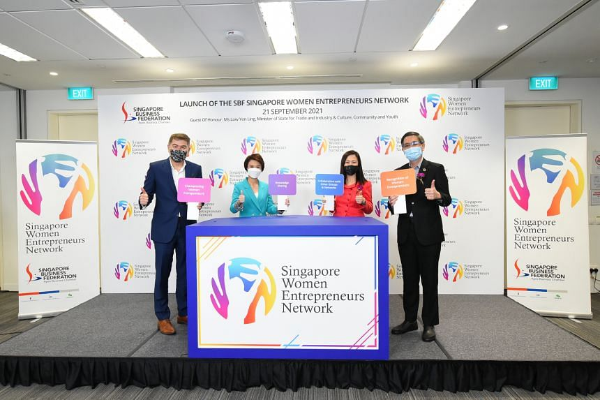 (From left) SBF chairman Lim Ming Yan; Ms Low Yen Ling, Minister of State for Trade and Industry and Culture, Community and Youth; Ms Rachel Eng, who chairs SG-WEN's executive committee; and SBF chief executive Lam Yi Young.