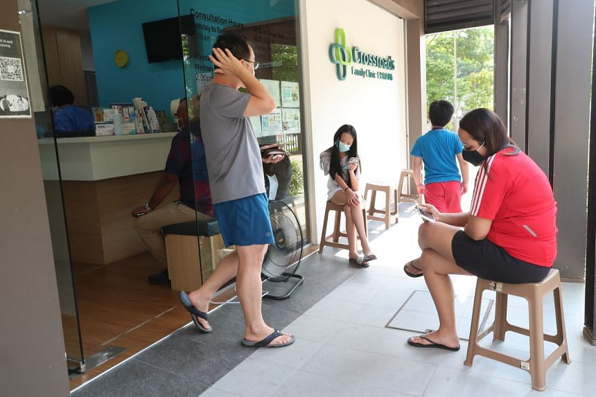People waiting outside Crossroads Family Clinic in Tampines on Sept 21, 2021.