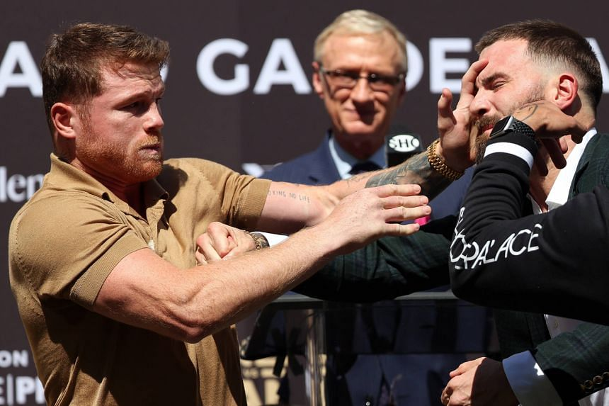 Canelo Alvarez (left) slaps Caleb Plant during a press conference in Beverly Hills on Sept 21, 2021.