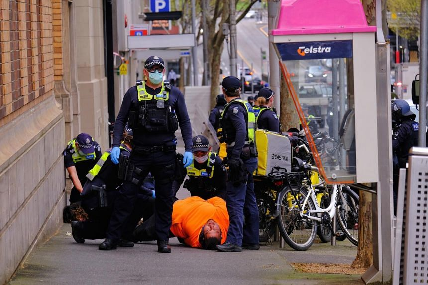 Victoria Police make arrests during a protest against Covid-19 restrictions in Melbourne on Sept 22, 2021.