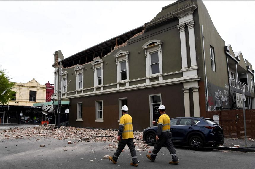 Emergency and rescue officials examining a damaged building in Chapel Street in Melbourne on Sept 22, 2021.