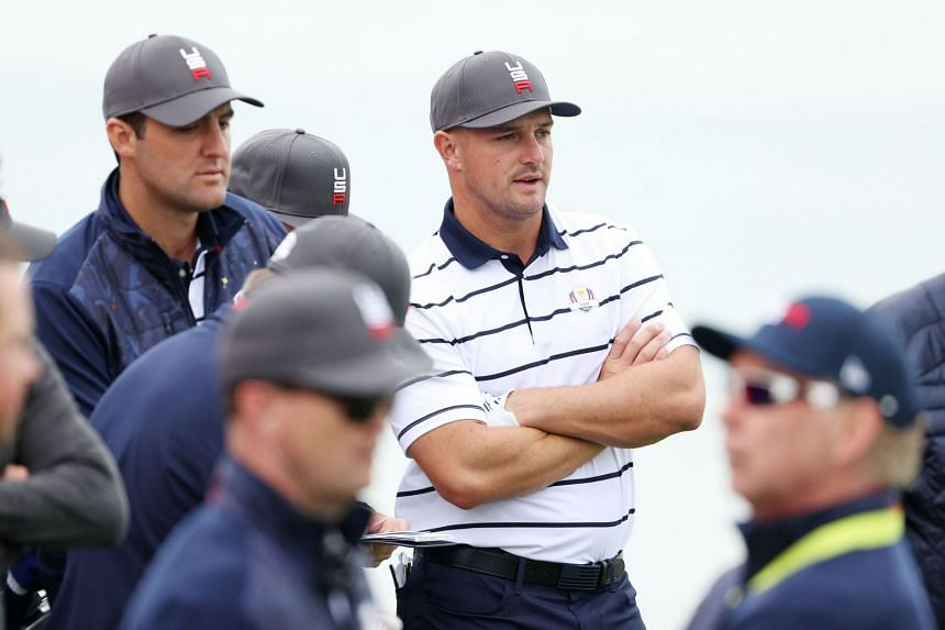 US team members Scottie Scheffler (left) and Bryson DeChambeau look on prior to the 43rd Ryder Cup at Whistling Straits on Sept 21, 2021.