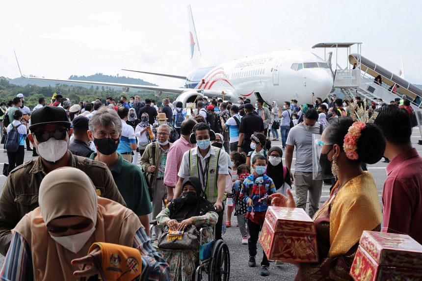 Tourists arriving at Langkawi's airport after the island opened to domestic visitors on Sept 16, 2021.