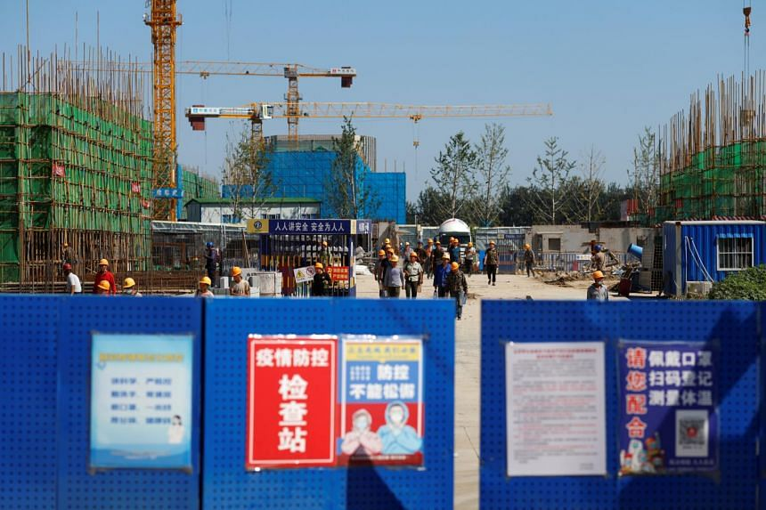 Workers inside the construction site of a project developed by China Evergrande Group in Beijing on Sept 22, 2021.
