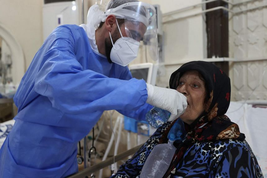 A Syrian health worker tends to a Covid-19 patient at the Ariha medical centre in the northwestern Syrian city of Idlib on Sept 13, 2021.