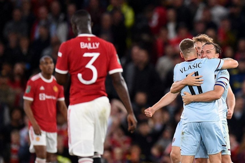 West Ham players (right) celebrate winning their League Cup third-round football match against Manchester United at Old Trafford in Manchester.