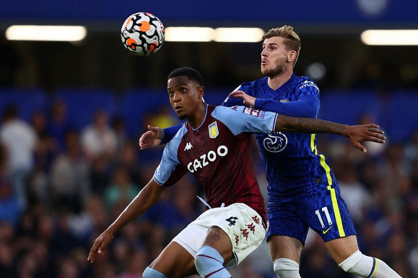 Timo Werner (right) fouls Ezri Konsa during the English Premier League football match between Chelsea and Aston Villa in London on Sept 11, 2021.