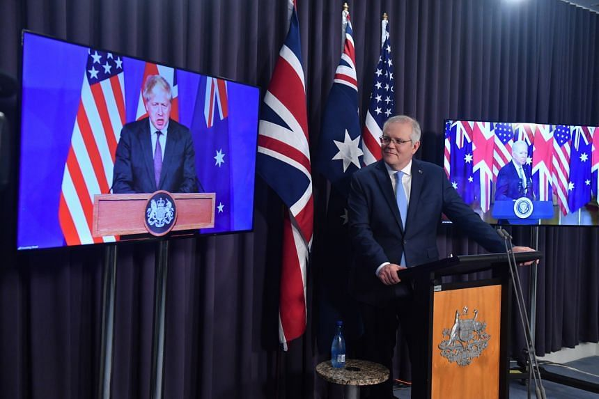 Australian Prime Minister Scott Morrison is seen during a joint press conference, in Canberra on Sept 16, 2021, with British Prime Minister Boris Johnson and US President Joe Biden attending virtually.