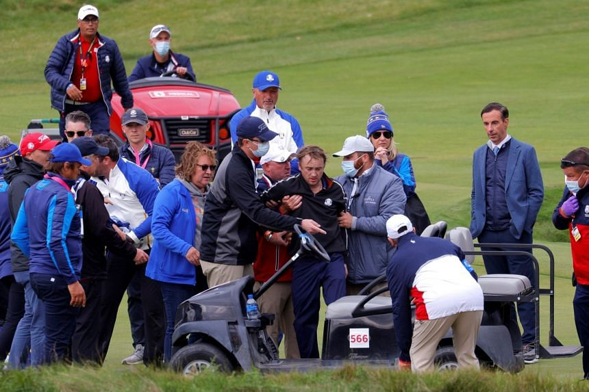 Actor Tom Felton receives medical attention during a practice round. He is representing Ireland in the Ryder Cup celebrity event.