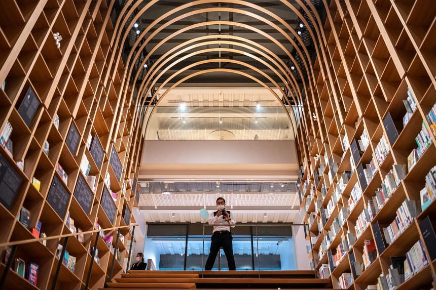 The wooden staircase forms the centrepiece of the Haruki Murakami Library at Waseda University.
