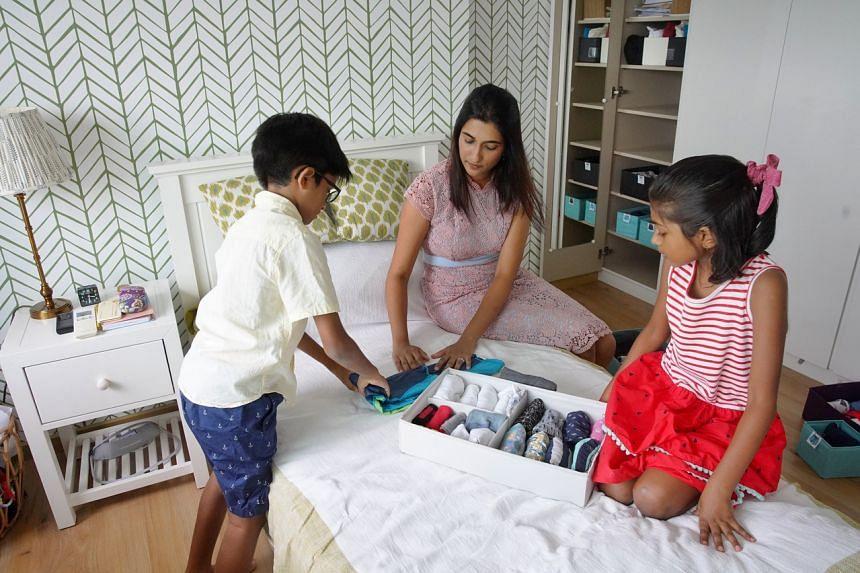 Certified KonMari consultant Aparna Chari Sundar with her children in their home.