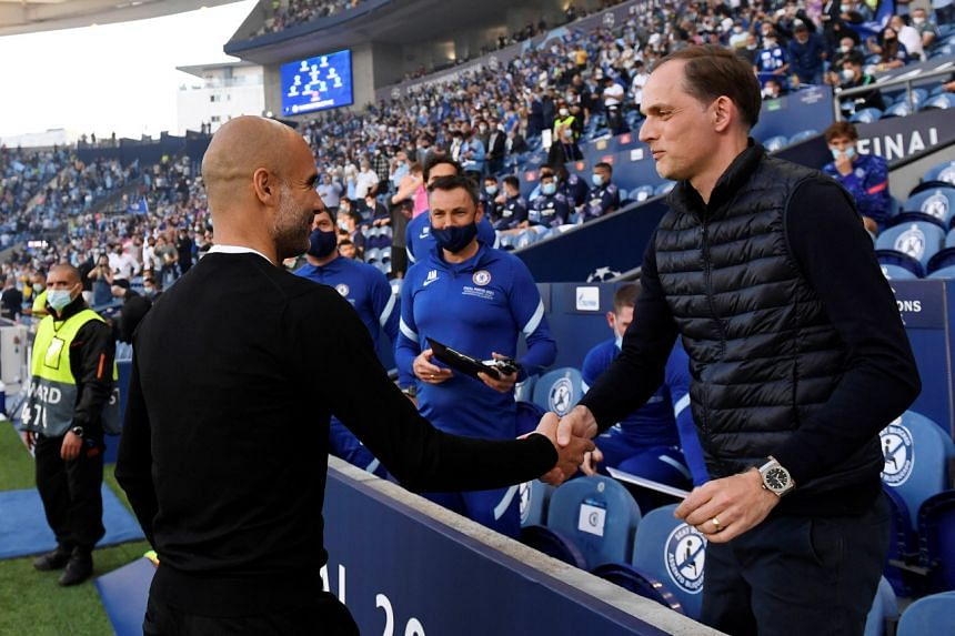 Manchester City manager Pep Guardiola with Chelsea manager Thomas Tuchel before the Champions League final in Portugal on May 29, 2021.