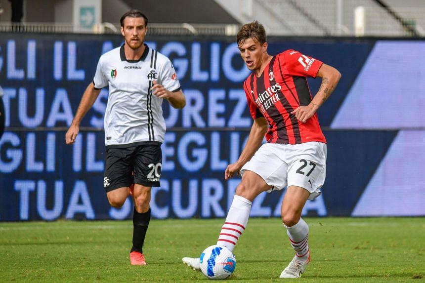 AC Milan's Daniel Maldini (right) in action during a match against Spezia Calcio, in La Spezia, Italy, on Sept 25, 2021.