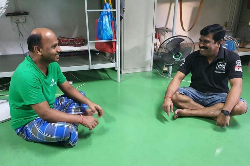 Mr Letchumanan Muralidharan (right), a resident of PPT Lodge 1B dormitory, speaks to his roommate Mr Maruthai Asari Balamurugan.
