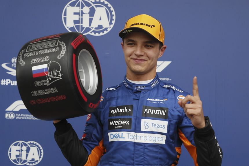 McLaren's driver Lando Norris celebrates after taking pole position during the qualifying session in Sochi, Russia, on Sept 25, 2021.