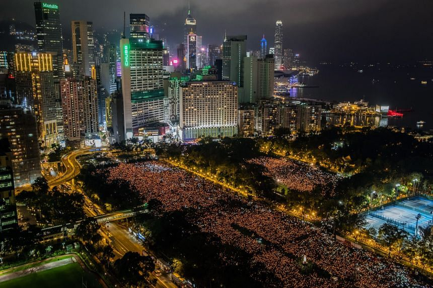 In a photo from June 4, 2019, thousands participate in an annual Tiananmen vigil at Victoria Park in Hong Kong.