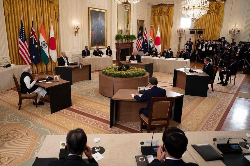 (Clockwise from left) India PM Narendra Modi, US President Joe Biden, Australia PM Scott Morrison, US Secretary of State Antony Blinken and Japan PM Suga Yoshihide meet at the White House on Sept 24, 2021.