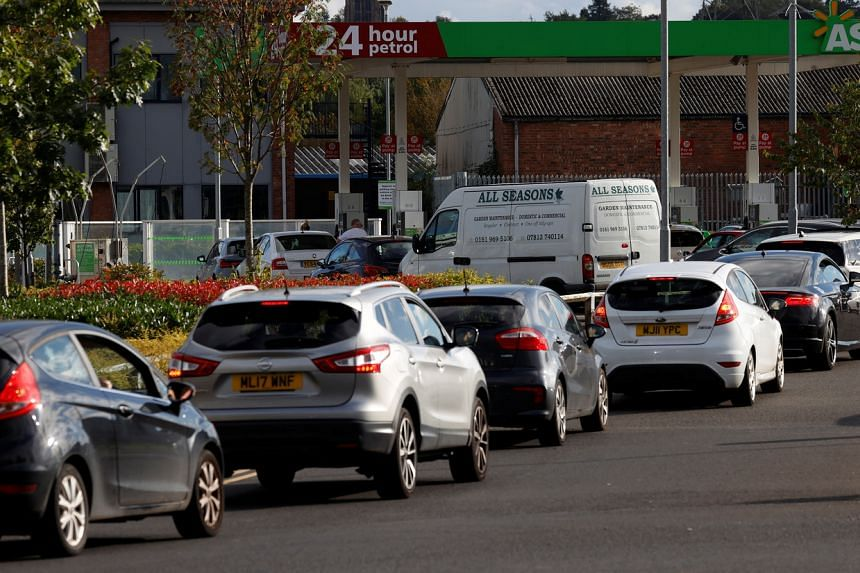 Motorists queue for fuel at a filling station in Manchester on Sept 24, 2021.