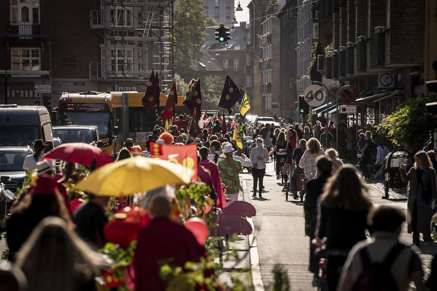 Christiania marks its 50th anniversary with a parade from the free town to the Town Hall Square in Copenhagen on Sept 22, 2021.