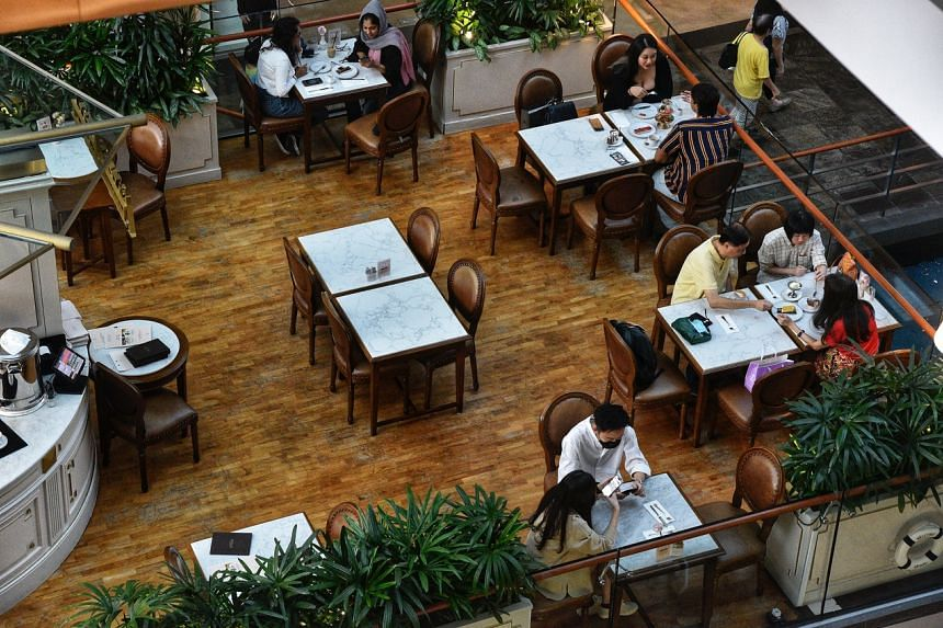 People dining at a restaurant in The Shoppes at Marina Bay Sands on Sept 25, 2021.
