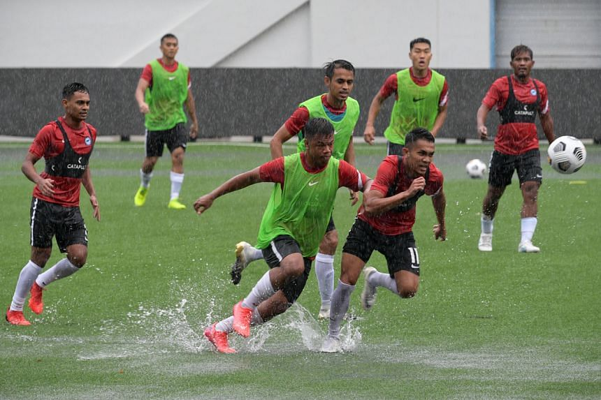 Under-23 players Saifullah Akbar (second from left) and Nur Adam Abdullah (front, in green vest) at the Lions' training, on Aug 31, 2021.