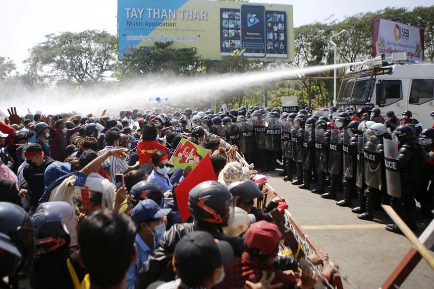 In this photo taken on Feb 9, 2021, police fire water cannons at protesters as they continue to demonstrate against the military coup in Naypyidaw.