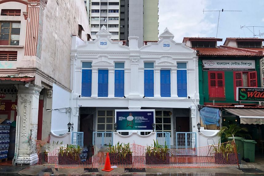 Two adjoining shophouses undergoing extensive restoration in Desker Road in Little India.