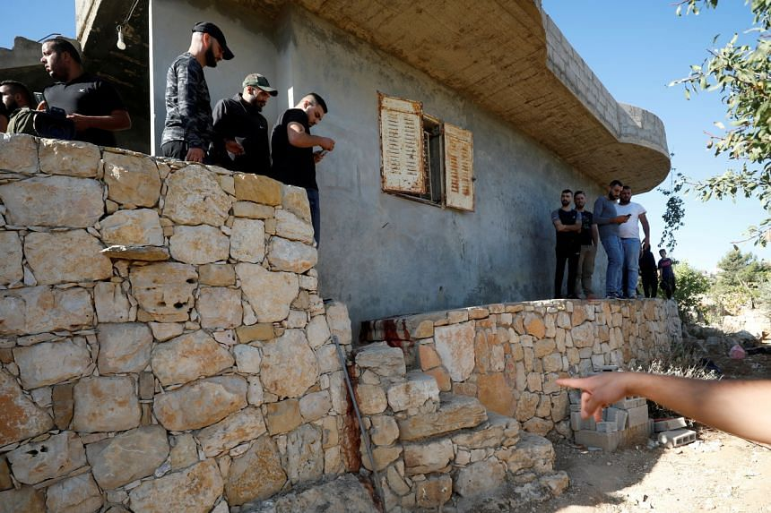 Palestinians check the scene where Hamas militants were killed by Israeli forces in the Israeli-occupied West Bank on Sept 26, 2021.