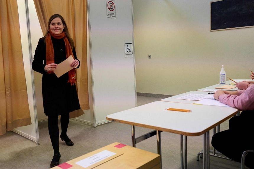 Iceland's Prime Minister Katrin Jakobsdottir casting her ballot in Reykjavik on Sept 25, 2021.