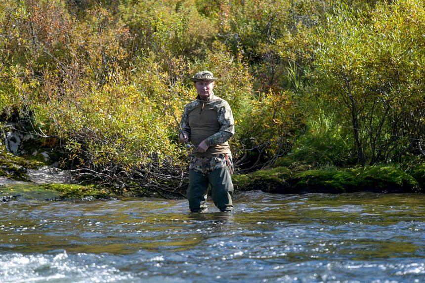 Russian President Vladimir Putin fishing during his holiday in Siberia.
