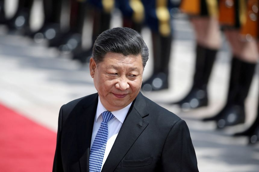 """Chinese President Xi Jinping expressed hope that China's ruling Communist Party and Kuomintang could cooperate on """"seeking peace in the Taiwan Strait""""."""
