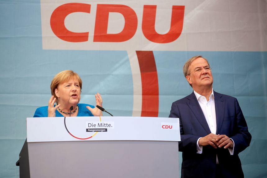 Dr Angela Merkel and Mr Armin Laschet, attend a rally ahead of the general election, in Aachen, Germany, on Sept 25, 2021.
