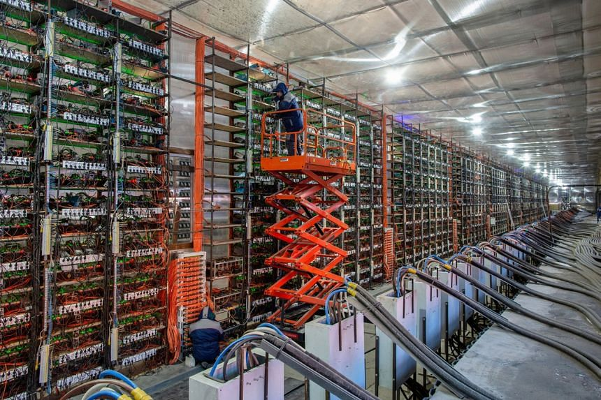 Rigs at the CryptoUniverse cryptocurrency mining farm in Russia in March.