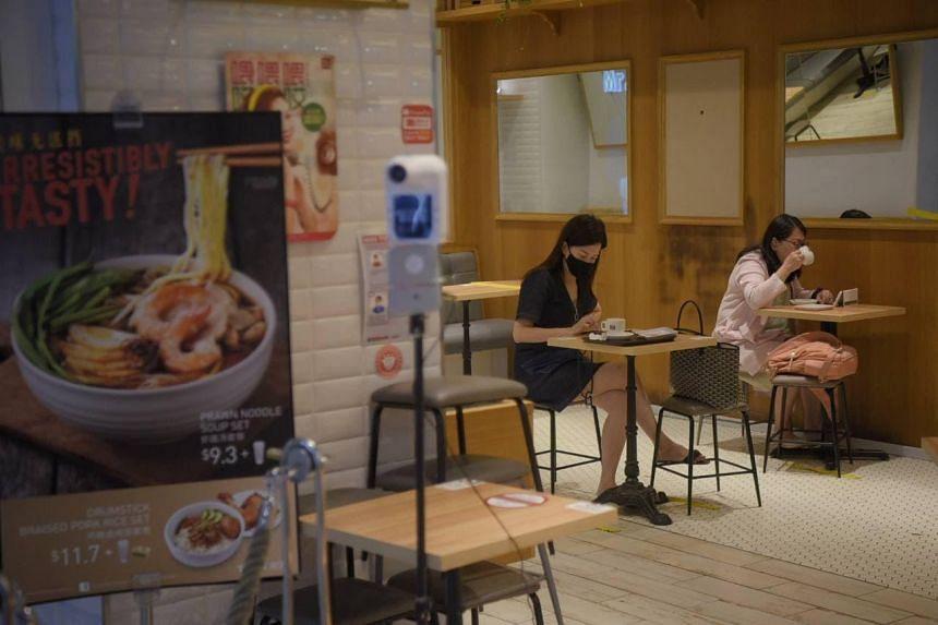 People eating breakfast at Toast Box at VivoCity on Sept 27, 2021.